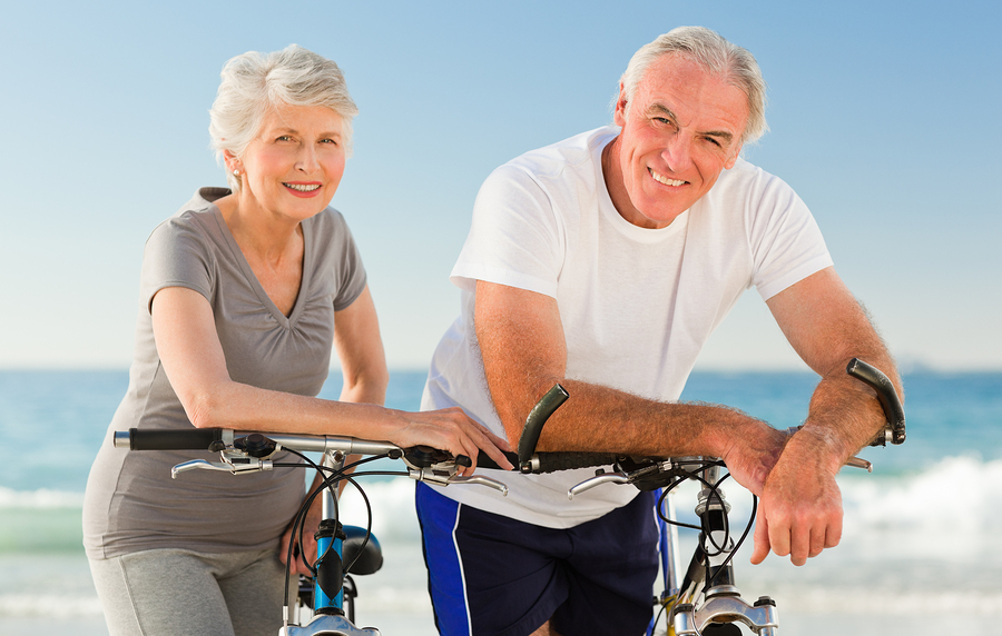 bigstock-Retired-couple-with-their-bike-14496875